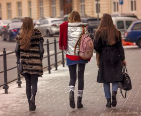 Young women walking down street