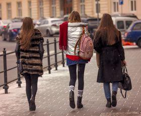 Young women walking down street