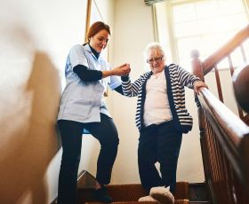Care worker helping older person