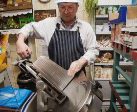 A butcher working cutting meat