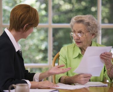 Older woman speaking to adviser