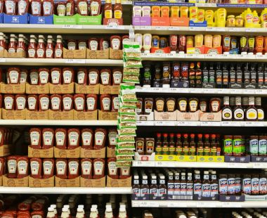 Supermarket shelves containing bottles of sauce