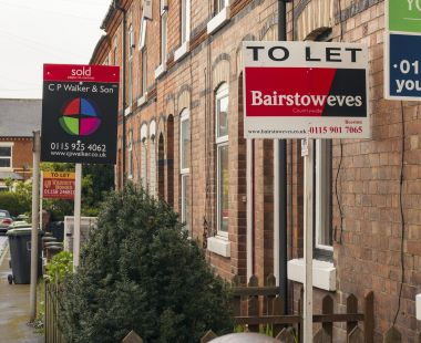 Row of houses with to let signs