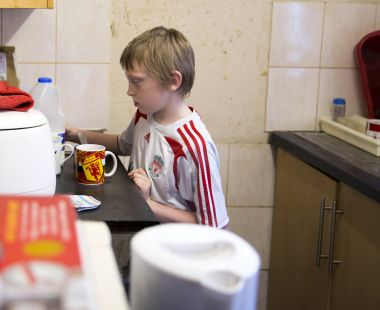 Child making tea