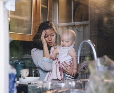 Stressed mum with baby