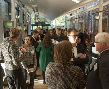 Crowd getting involved and talking at an event