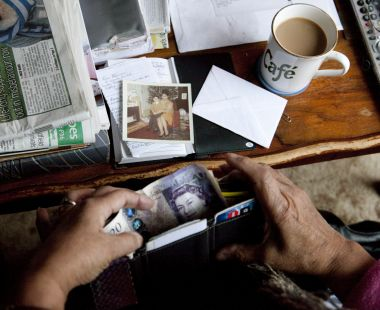Pulling banknotes from a wallet