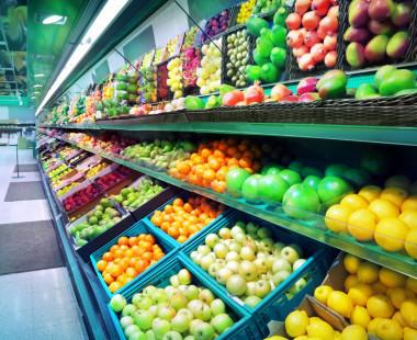 Supermarket shelves stocked with fresh fruit and veg