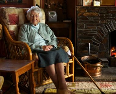 Elderly woman sat in an armchair