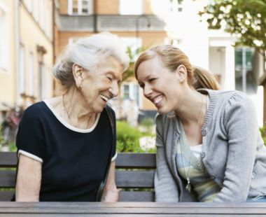 An older and younger woman having a conversation