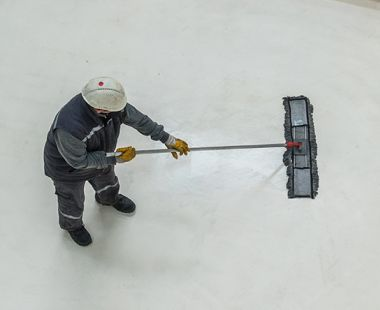 Worker cleaning floor