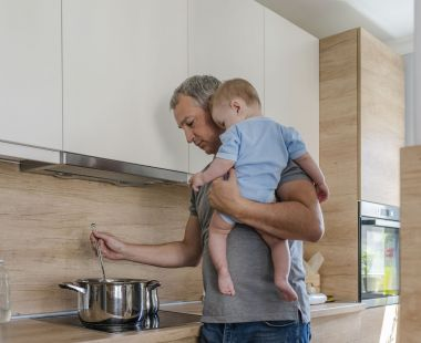 Dad and baby cooking