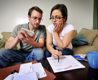 Young couple paying bills